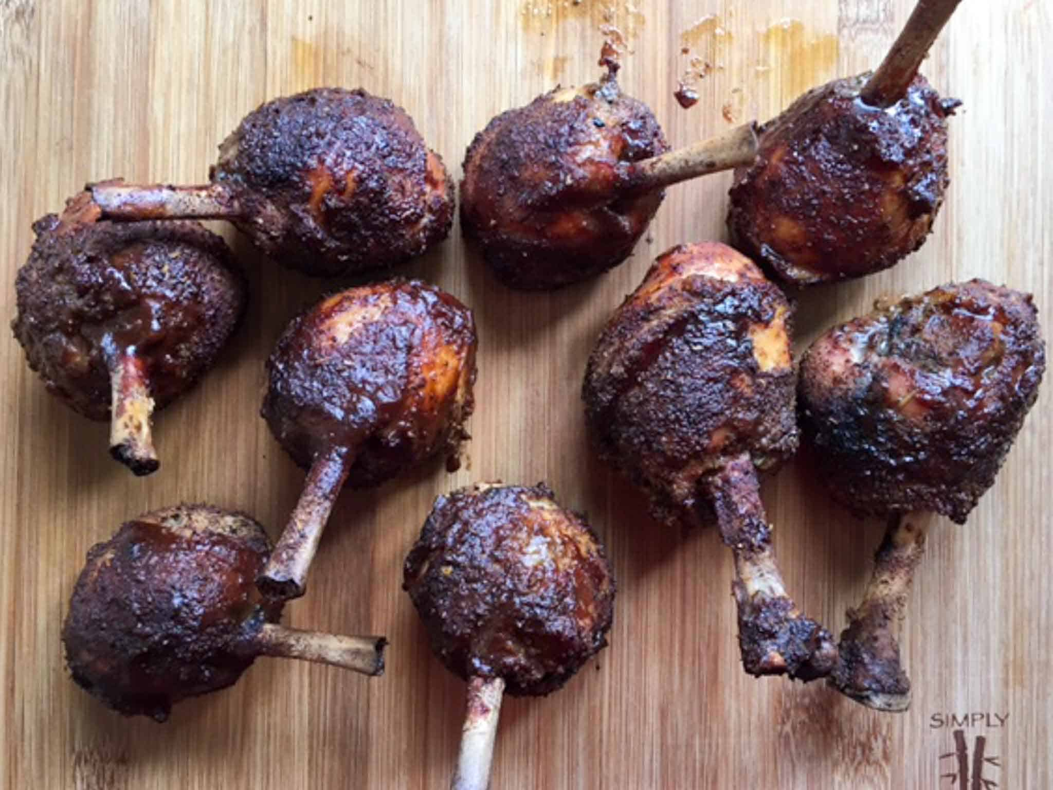Chicken Lollipops smoked on wooden cutting board overhead shot