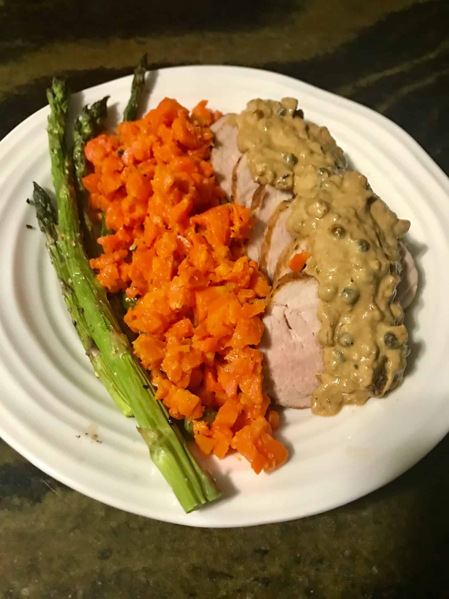 Home Chef Peppered Pork Tenderloin on plate with mashed carrots and asparagus