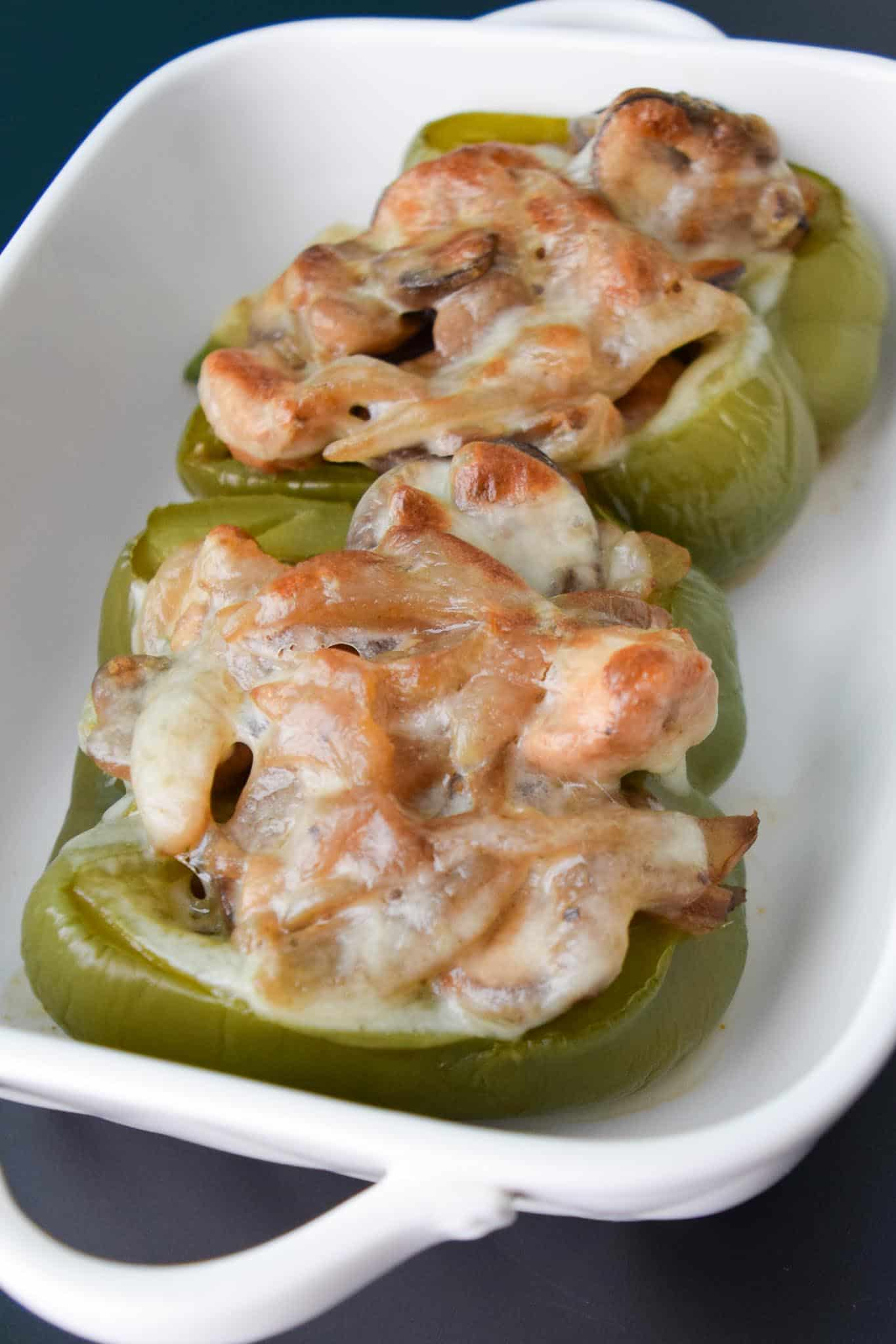 Chicken Philly Stuffed Peppers cooked in white dish close up view
