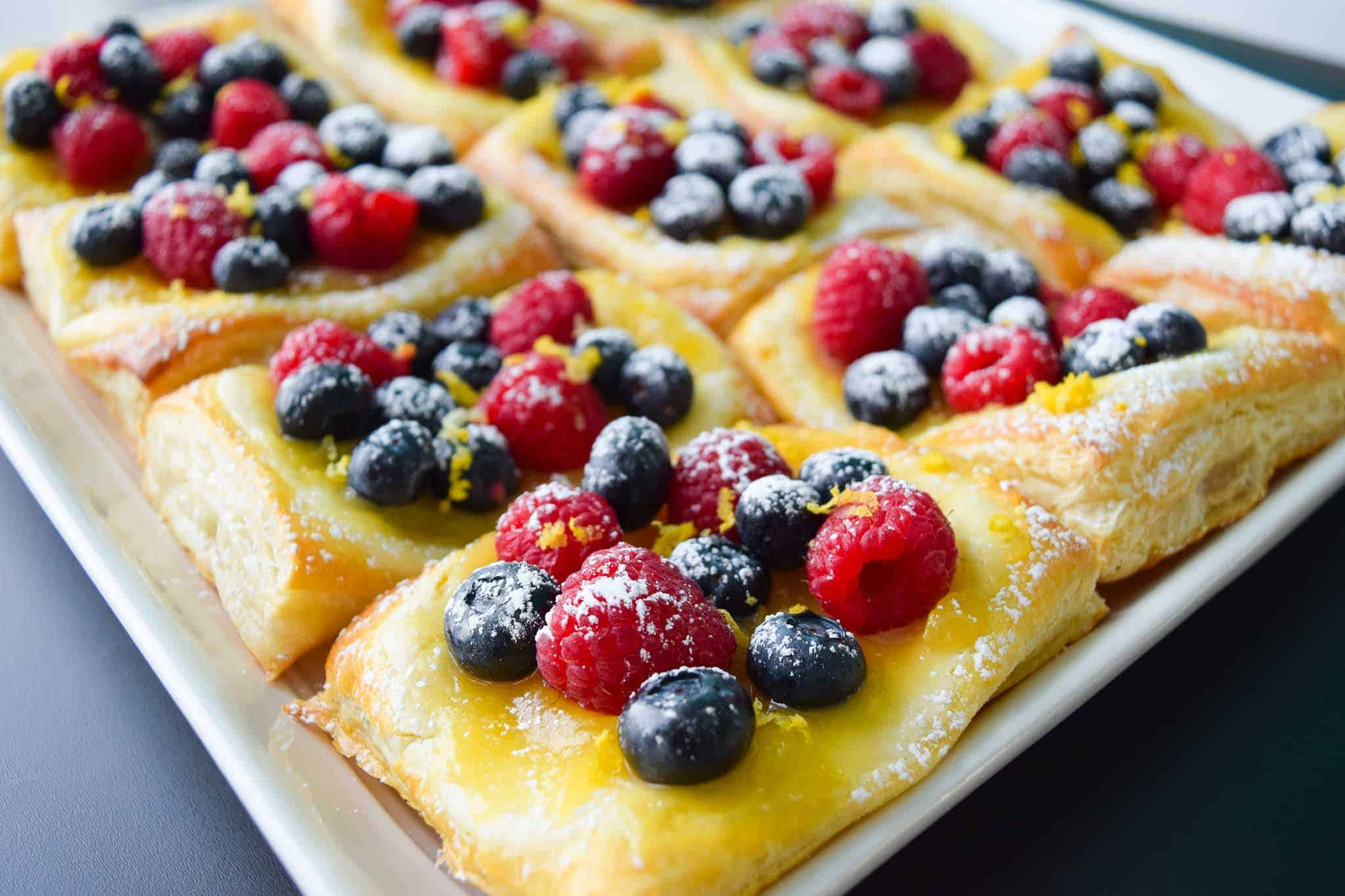 Lemon and Berry Cheesecake Puff on serving tray side view