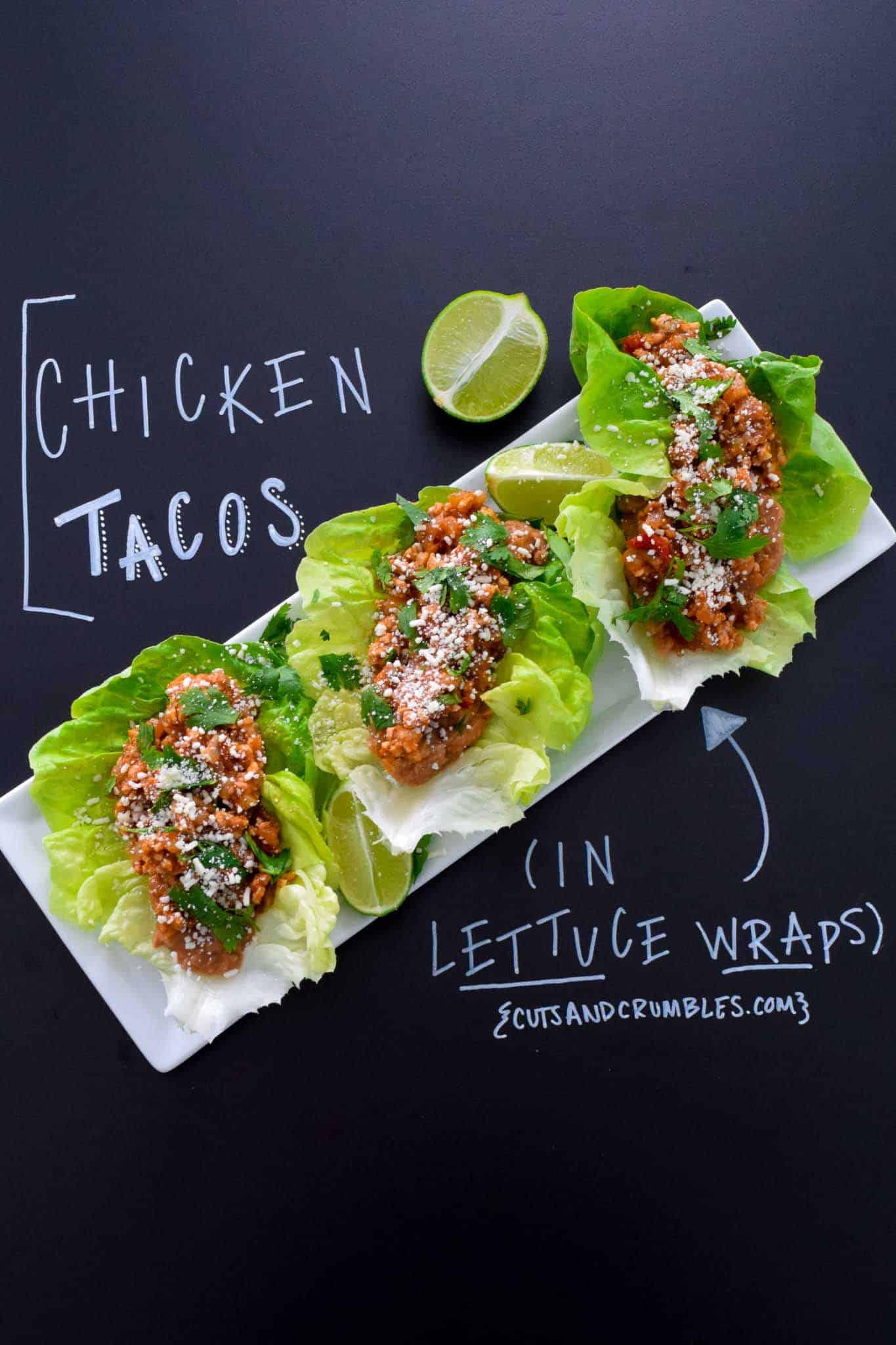 Chicken Tacos in Lettuce Wraps with title written on chalkboard