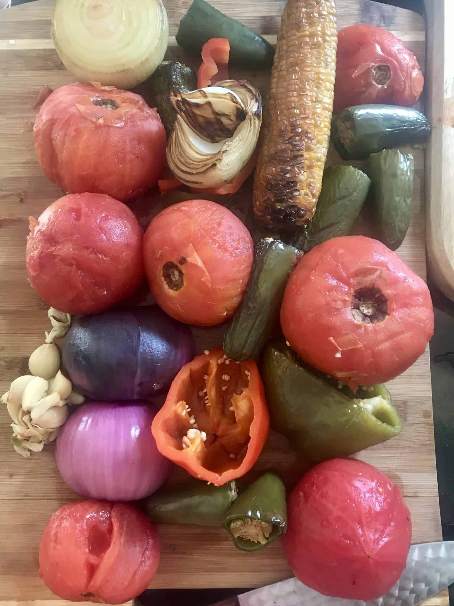 Smoked vegetables on wooden cutting board overhead shot