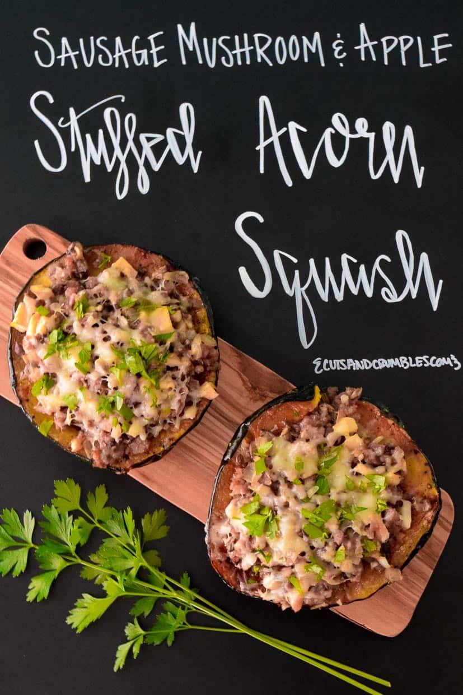 Stuffed Acorn Squash on wooden platter with title written on chalkboard