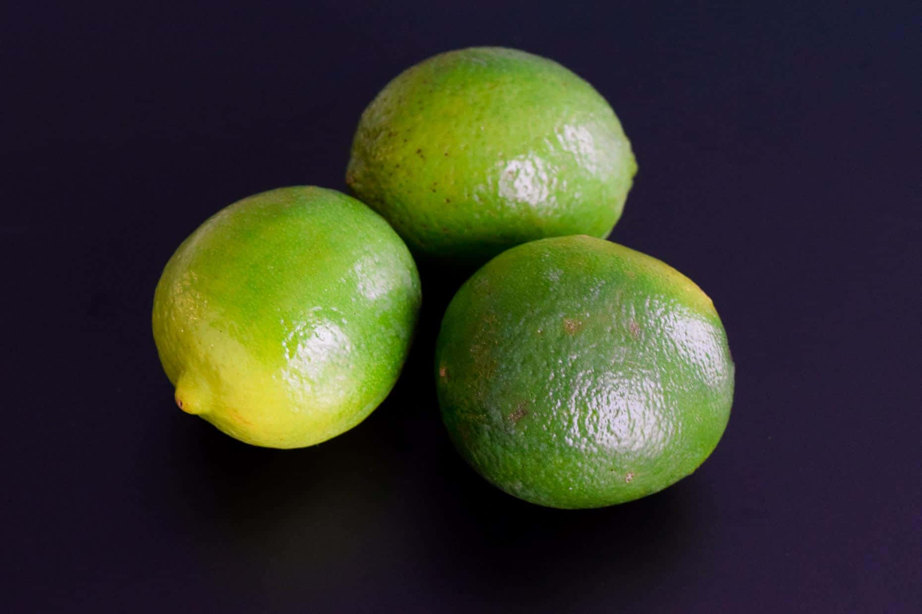 Limes on black background