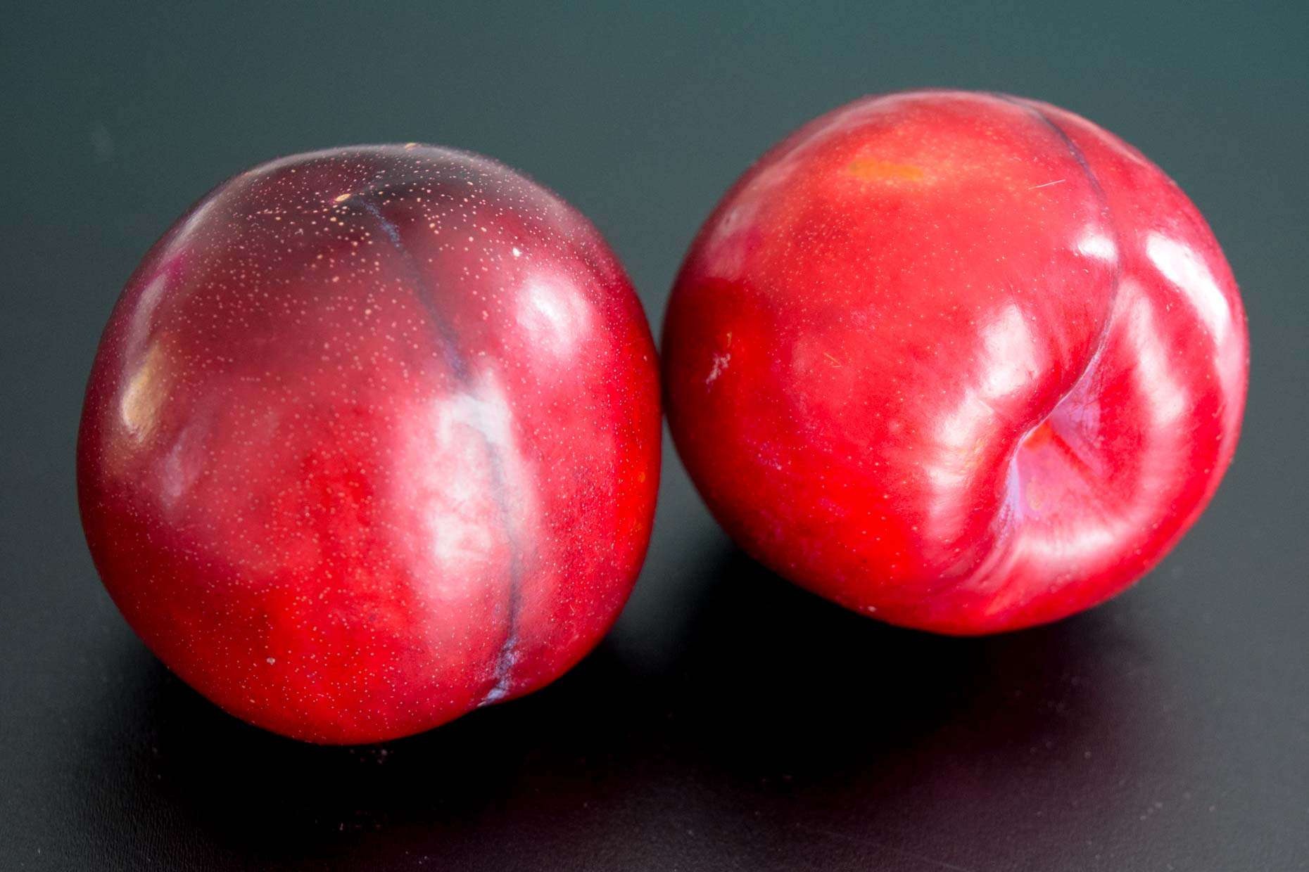 Plums on black background