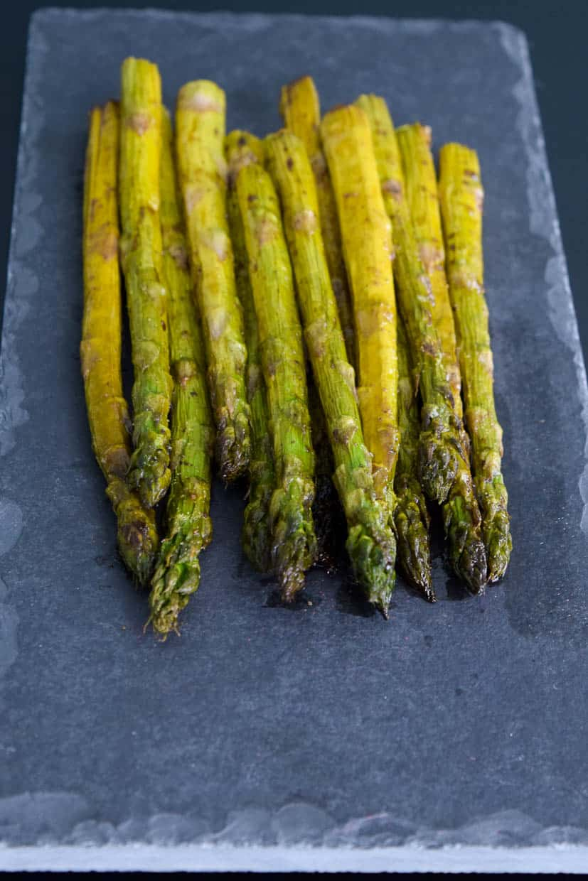 Easy Roasted Asparagus on slate platter side view