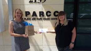 Ciara presenting SPARCC with our monetary donation-min
