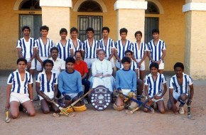 With his hockey teammates (sixth from the left standing)