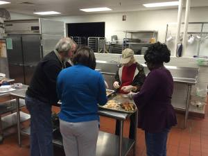 Volunteers prepare food for MLK Day luncheon.