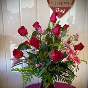 Red roses and asiatic lilies in red vase