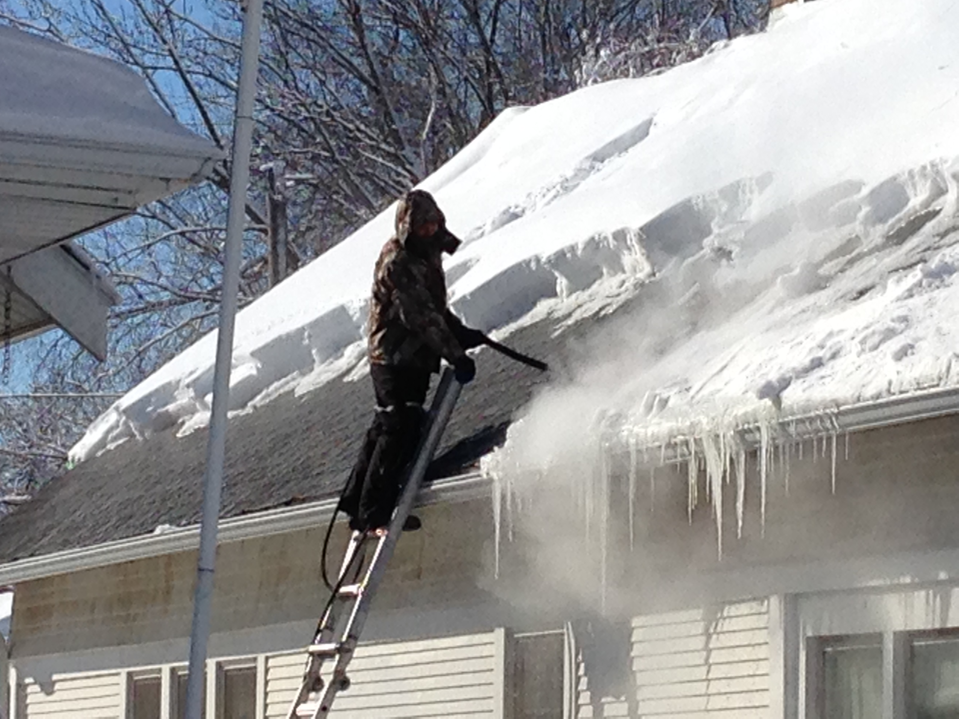 Rooftop ice dam removal, ice dam steaming