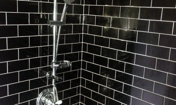 St. Paul, MN tiled shower wall installer, black subway tile with white grout