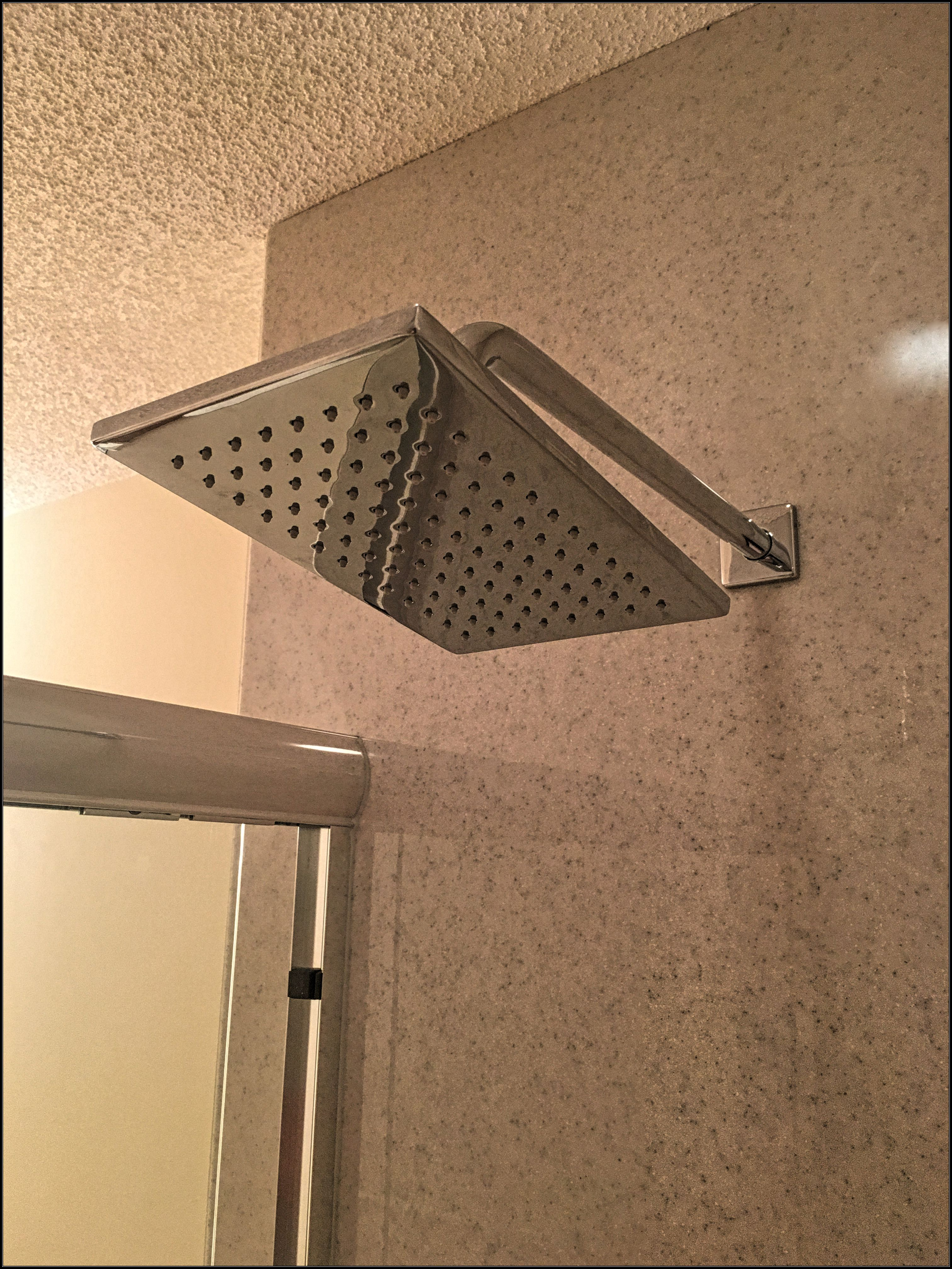 Chrome Delta Vero rain fall shower head on a Onyx Collection shower install project