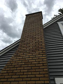 large chimney repair. tuck pointing chimney service.