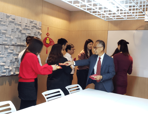 CW co-founder Mr. Thomas Wong giving out red packets to staff