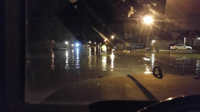 Walking slowly through a flooded neighborhood