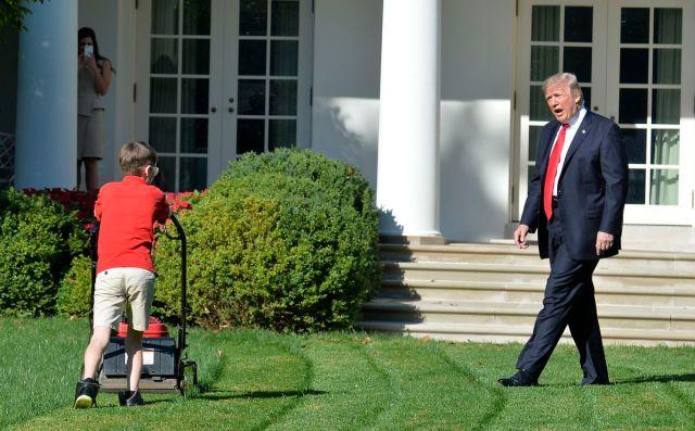 Donald Trump watches Frank Giaccio, 11, mow the White House lawn.