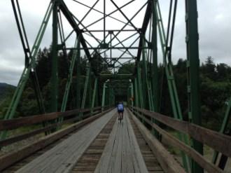 Dan crossing the Honeydew Bridge over the Mattole River.