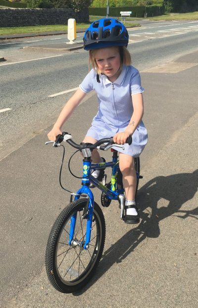6 year old girl Squish Bike cycling to school