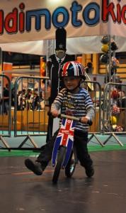 Birmingham NEC Cycle Show - child riding the Kiddimoto Kurve Union Jack Balance Bike review test ride