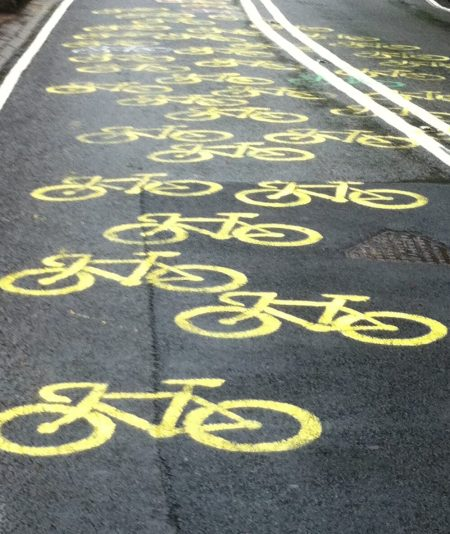 Yellow bikes painted on road during Tour de France