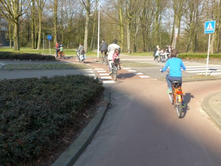 Cycling with kids across a junction in Amsterdam