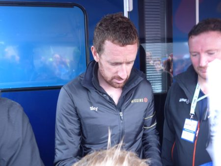 Bradely Wiggins signing an autograph for a young fan - stage 2 of Tour of Britain 2016