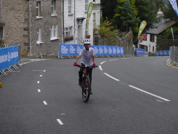 7 year old riding his Islabike up Beast Banks Kendal, Tour of Britain 2016