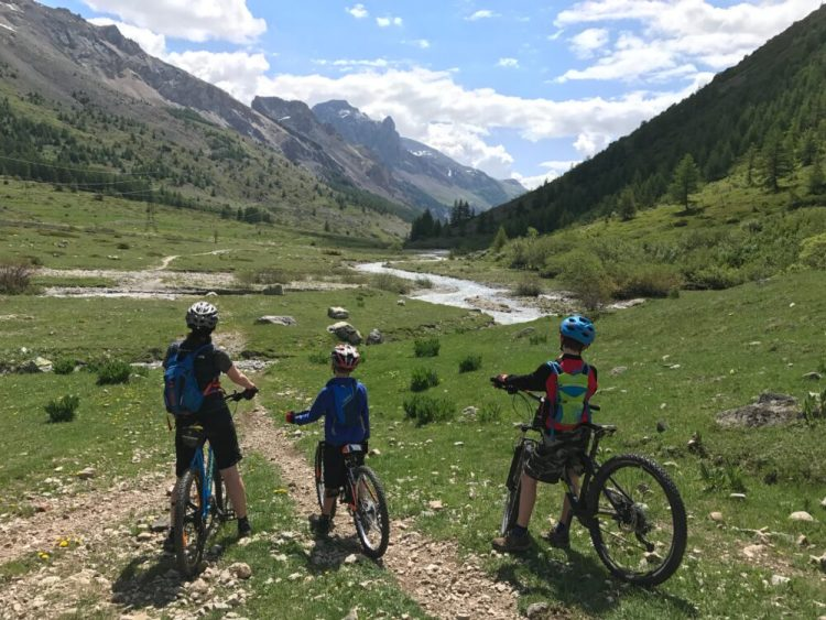 Family cycling at Col du Lautaret, French Alps during the May half term