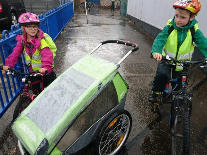 Kids riding their bikes to school