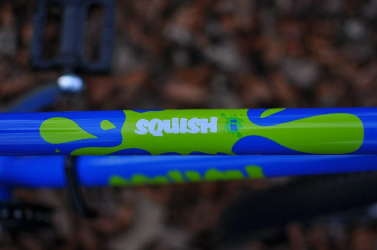Squish Bikes branding - the Squish 18 is blue and lime green