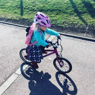 Riding an Islabike Cnoc in pink dress