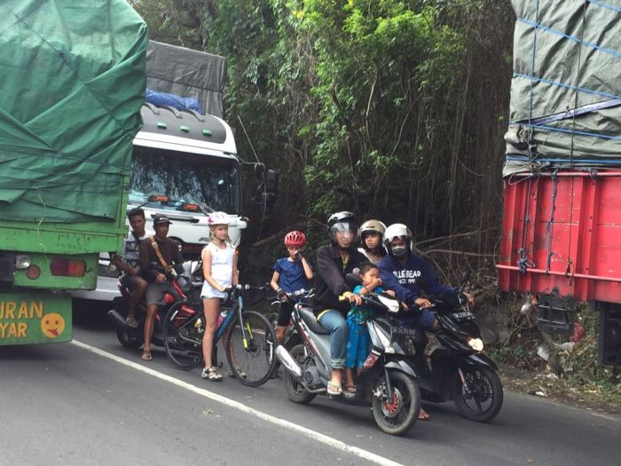 Cycling with kids in the traffic on Indonesia Bali