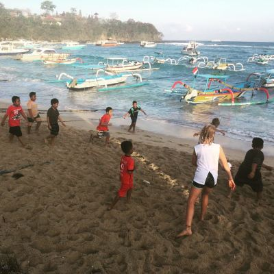Playing with the locals on family cycling holiday Bali Indonesia