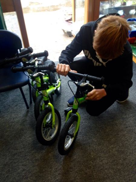 Doing M-Checks on balance bikes during the teachers course on how to teach kids to balance bike in school lessons