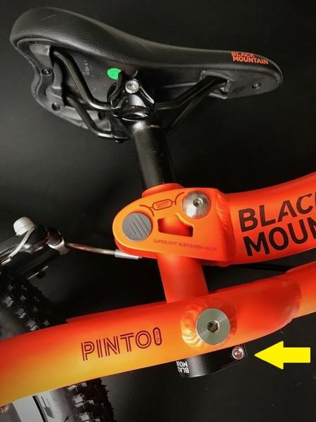 Adjusting the saddle on the Black Mountain Pinto balance bike