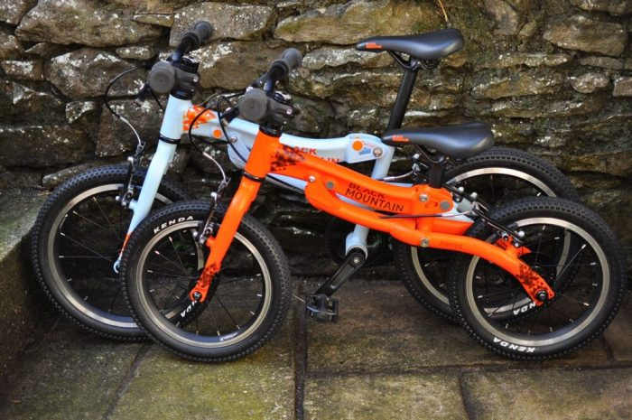 Black Mountain Pinto and Skog Bike Review - the two kids bikes next to each other showing the size difference