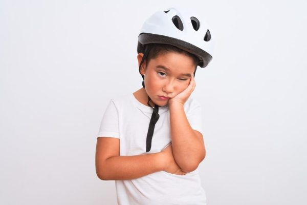 Sad child in bike helmet