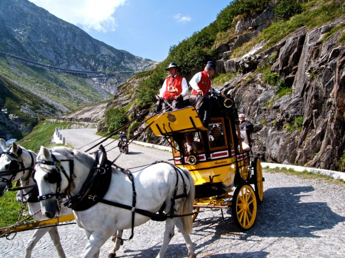 Horse-drawn carriage rides available. Galleria/tunnel can be seen above.