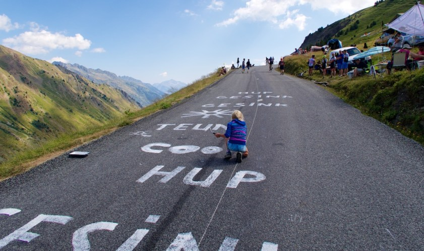A Young Girl Paints the Road