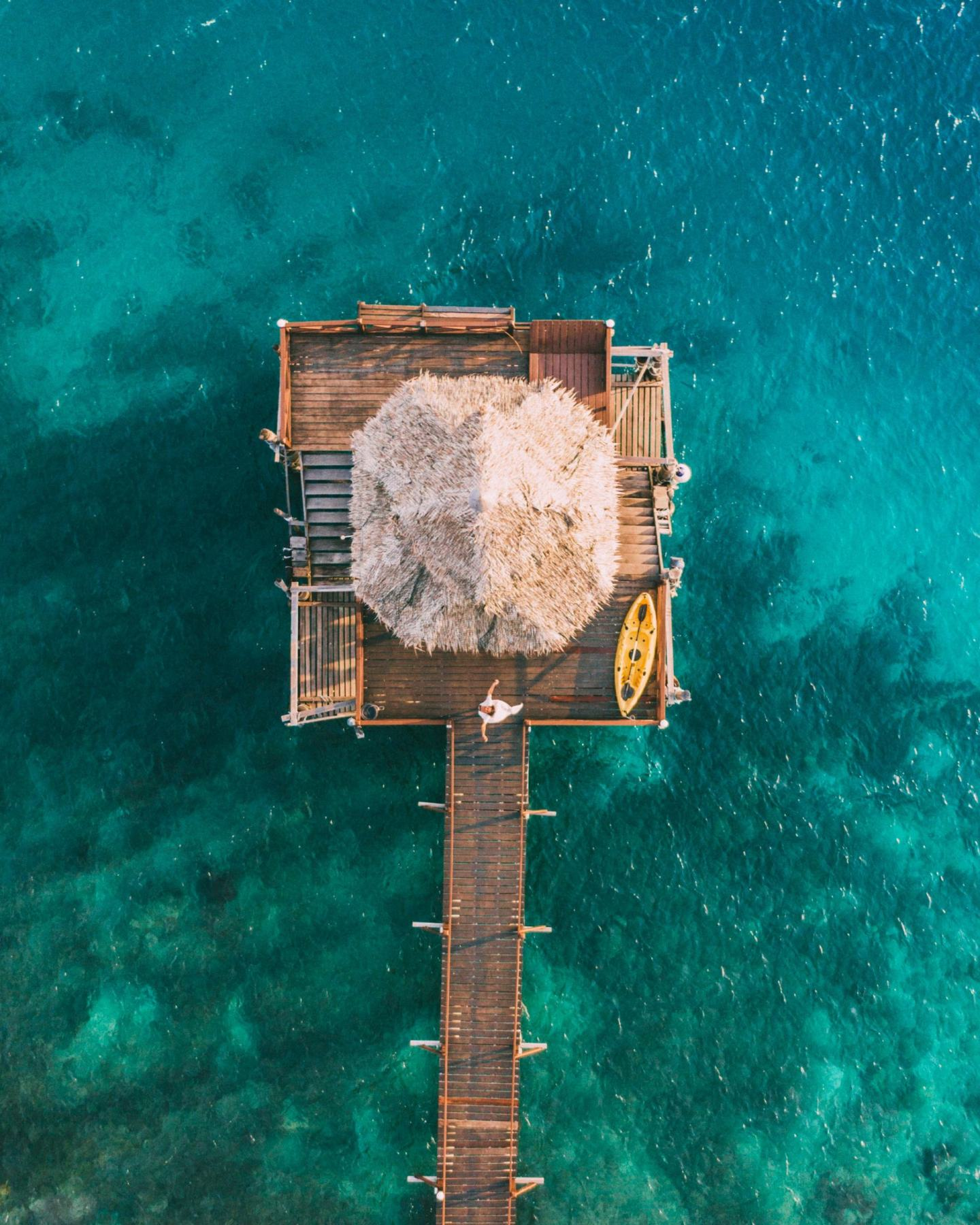 women walking in a jetty view from the sky