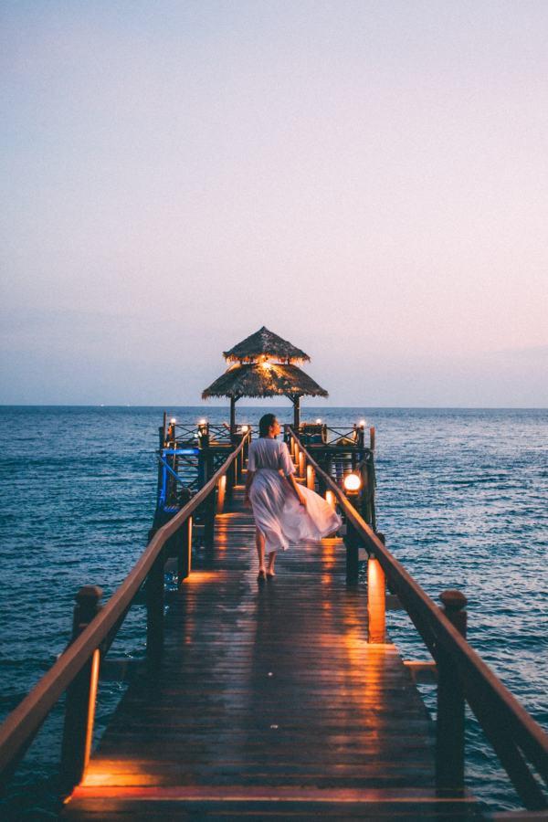 women walking in a jetty