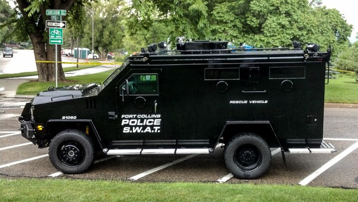 """SWAT at 4th of July. I love the """"rescue vehicle"""" on the side.  I feel safer already."""