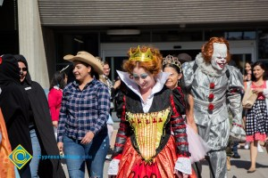 Students and staff wear Halloween costumes as they walk across campus
