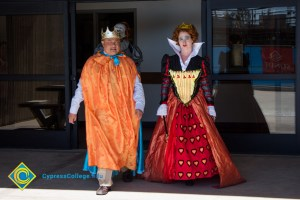 Staff dressed as the King and Queen of Hearts
