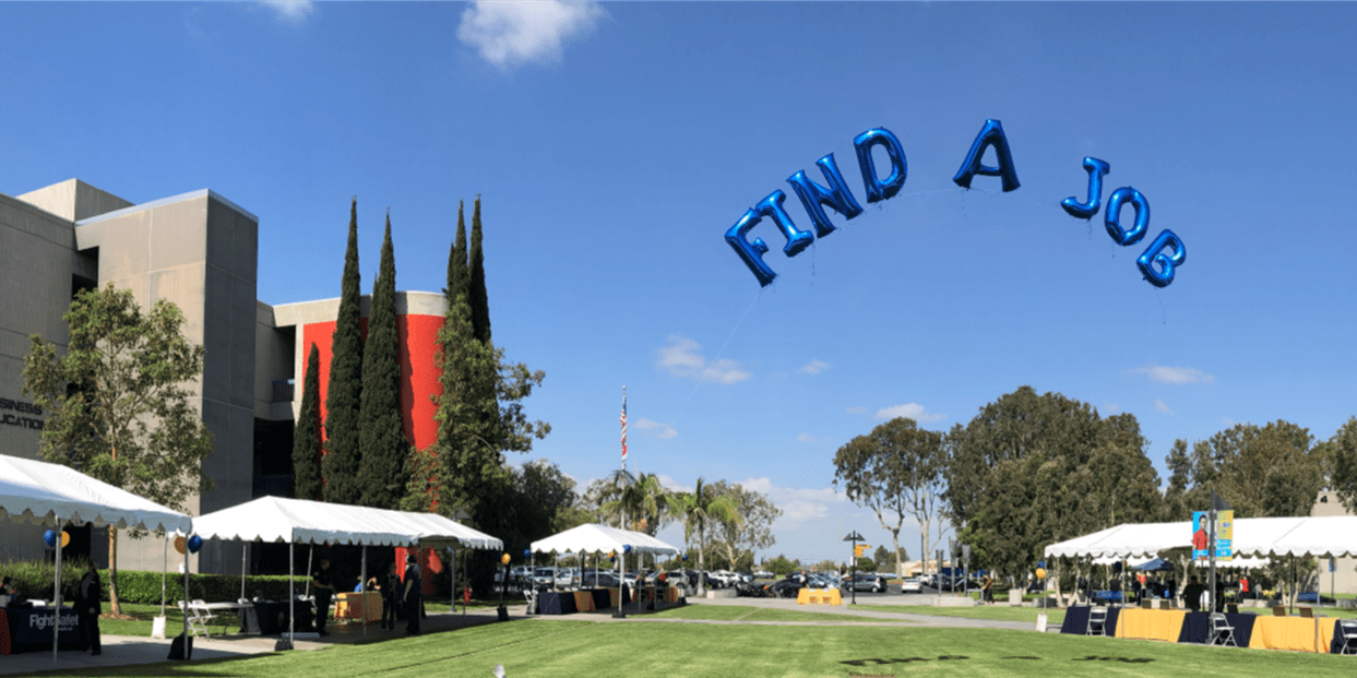 """Cypress College campus with """"Find a Job"""" baloons in sky"""