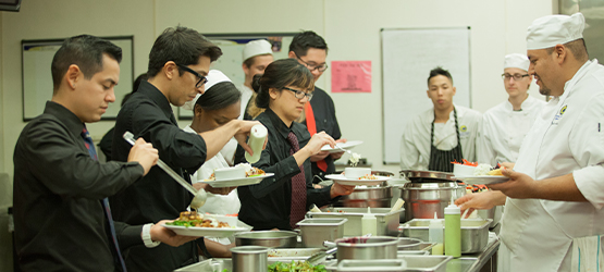 Students preparing meals in a kitchen