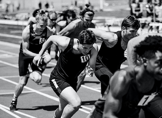 Athletes running on a track