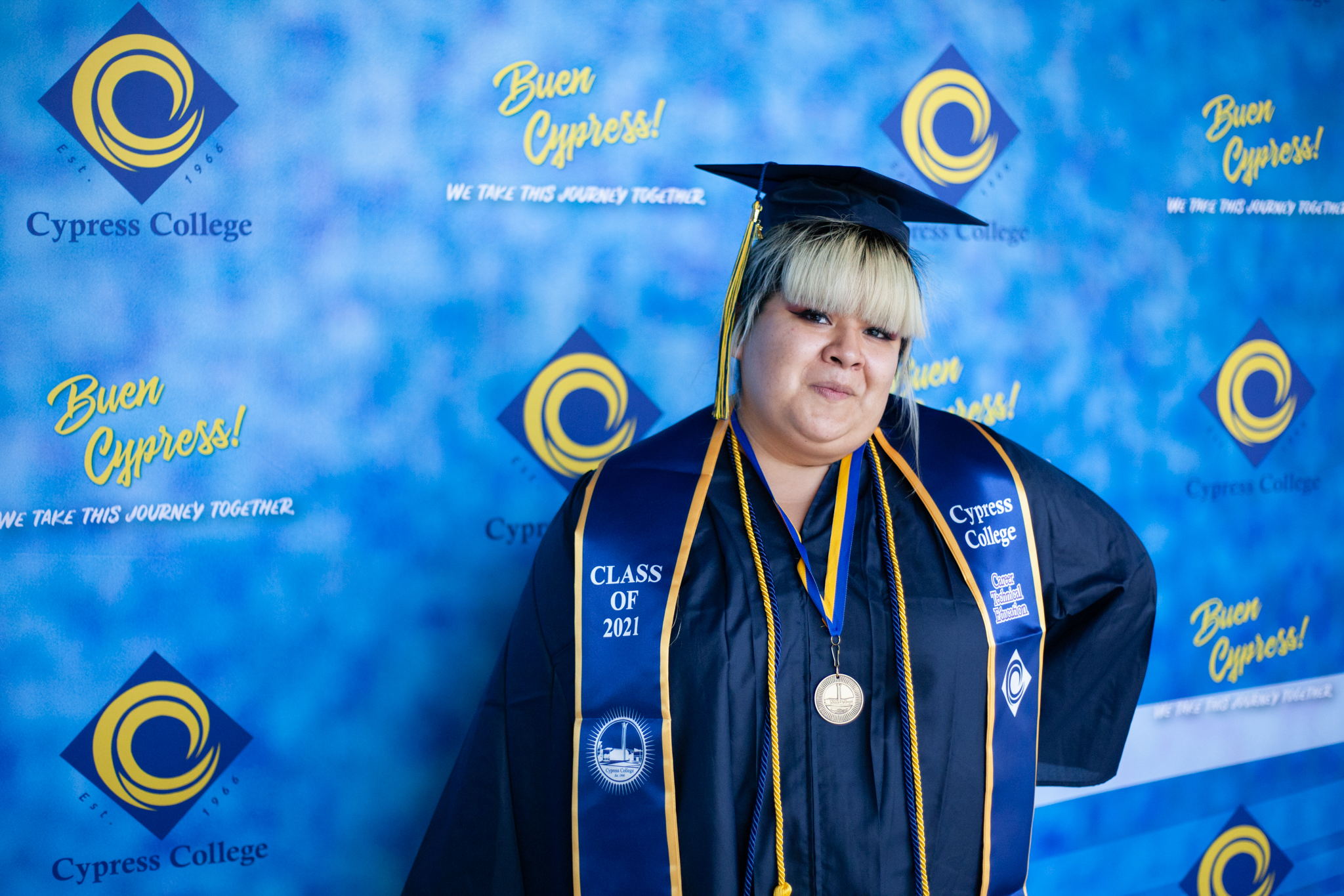 Culinary Arts student Alexandra Camacho poses in front of a blue background.