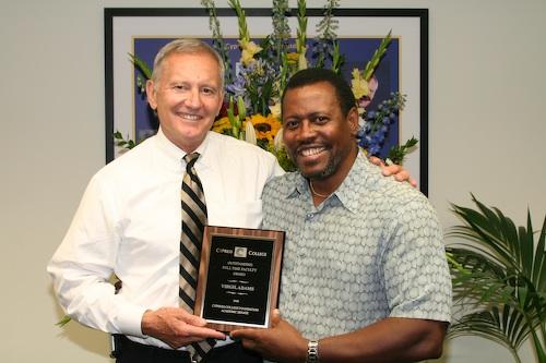 Professor Adams and Dr. Kassler holding plaque